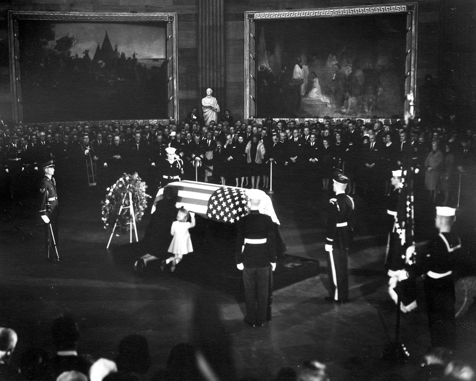 . Jacqueline Kennedy and daughter, Caroline, kneel before the casket as it lies in state in the rotunda of the Capitol. John F. Kennedy Presidential Library and Museum