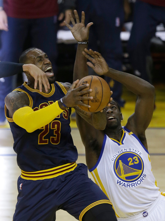 . Cleveland Cavaliers forward LeBron James, left, shoots against Golden State Warriors forward Draymond Green during the first half of Game 1 of basketball\'s NBA Finals in Oakland, Calif., Thursday, June 1, 2017. (AP Photo/Ben Margot)
