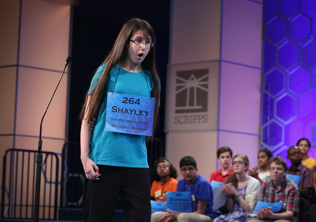 . Speller Shayley Grace Martin of Riner, Virginia, reacts after she correctly spelled his word during round six of the 2014 Scripps National Spelling Bee competition May 29, 2014 in National Harbor, Maryland. Forty-six spellers have advanced to the semifinals to compete for the top honor in the annual spelling contest.  (Photo by Alex Wong/Getty Images)