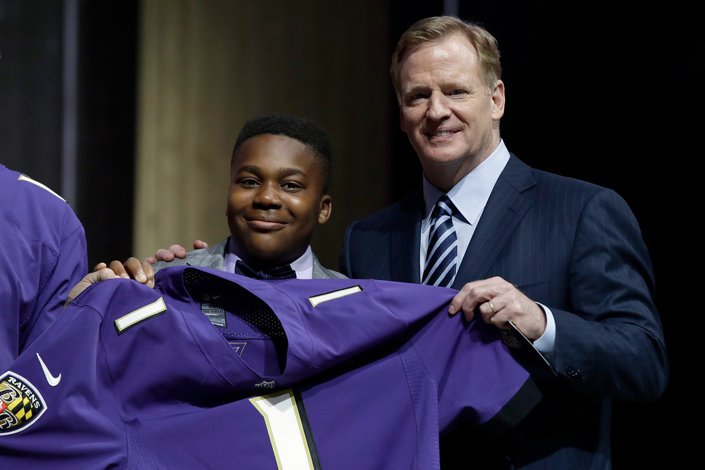. T.J. Owuanibe, 14, left, poses with NFL commissioner Roger Goodell after announcing the Baltimore Ravens\' selection during the first round of the 2017 NFL football draft, Thursday, April 27, 2017, in Philadelphia. (AP Photo/Matt Rourke)