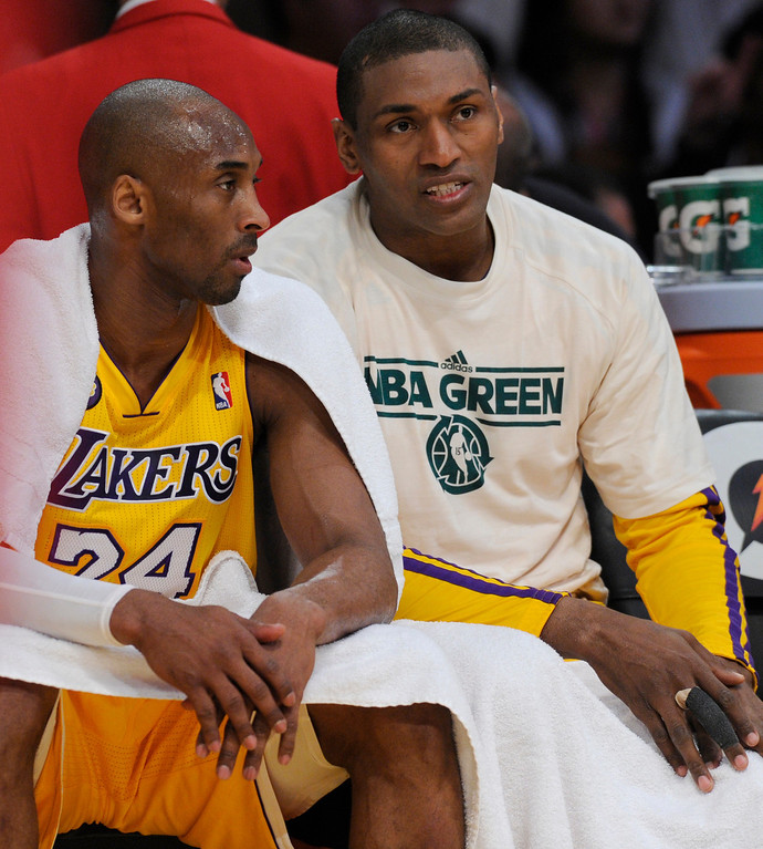 . Lakers Kobe Bryant and Metta World Peace talk over the game plan on the bench in the 2nd quarter. The Lakers played the New Orleans Hornets at Staples Center in Los Angeles CA 4/9/2013(John McCoy/Staff Photographer