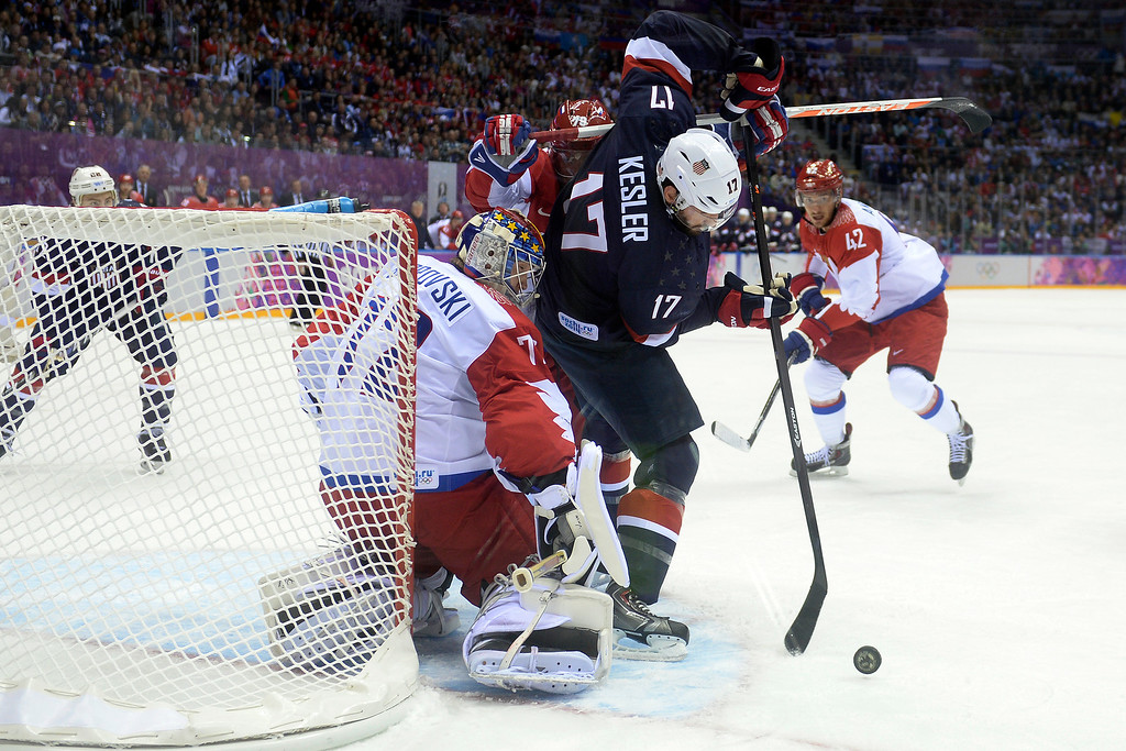 . SOCHI, RUSSIA - FEBRUARY 15: Ryan Kesler (17) of the U.S.A. cannot quite take a shot as Sergei Bobrovski (72) of the Russia defends during the first period of men\'s hockey action at Bolshoy arena. Sochi 2014 Winter Olympics on Saturday, February 15, 2014. (Photo by AAron Ontiveroz/The Denver Post)