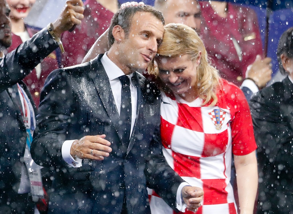 . French President Emmanuel Macron and Croatian President Kolinda Grabar-Kitarovic, right, attend the award ceremony at the end of the final match between France and Croatia at the 2018 soccer World Cup in the Luzhniki Stadium in Moscow, Russia, Sunday, July 15, 2018. France won 4-2. (AP Photo/Petr David Josek)