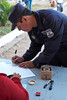 Election day in Santa Ana: <br /> A policeman signs the register indicating that he has voted.
