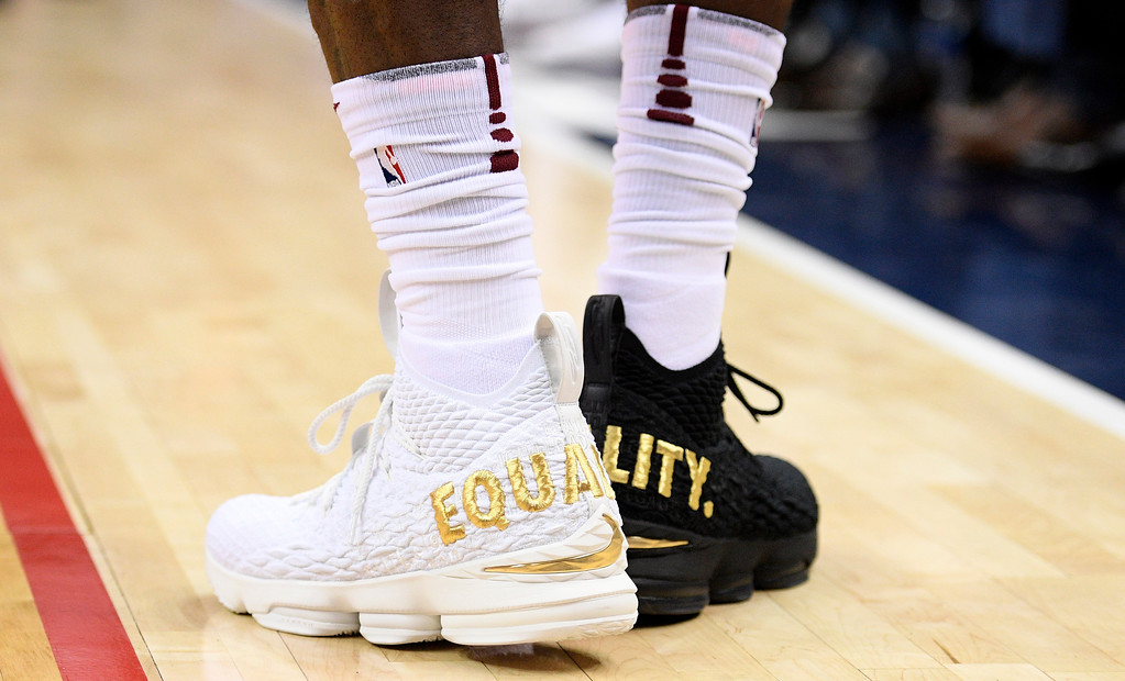 ". Cleveland Cavaliers forward LeBron James\' shoes are emblazoned with ""EQUALITY\"" on both heels during the first half of an NBA basketball game against the Washington Wizards, Sunday, Dec. 17, 2017, in Washington. (AP Photo/Nick Wass)"
