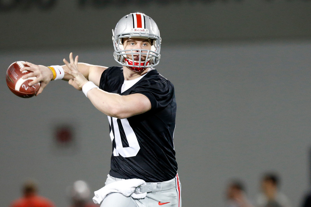 . Ohio State quarterback Joe Burrow drops back to pass during spring NCAA college football practice Tuesday, March 7, 2017, in Columbus, Ohio. (AP Photo/Jay LaPrete)