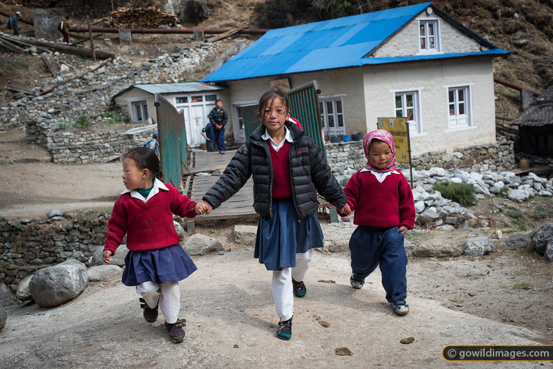 Kids on the way to school, near Phakding. It's not uncommon for children to walk up to 2 hours each way.
