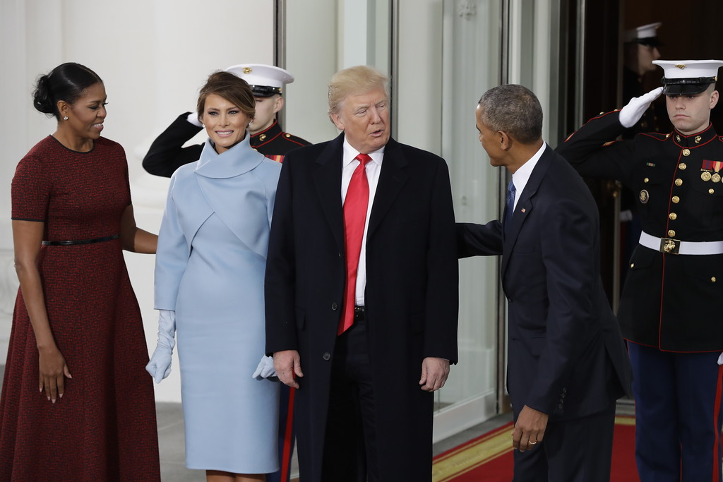 . President Barack Obama and first lady Michelle Obama greet President-elect Donald Trump and his wife Melania at the White House in Washington, Friday, Jan. 20, 2017. (AP Photo/Evan Vucci)