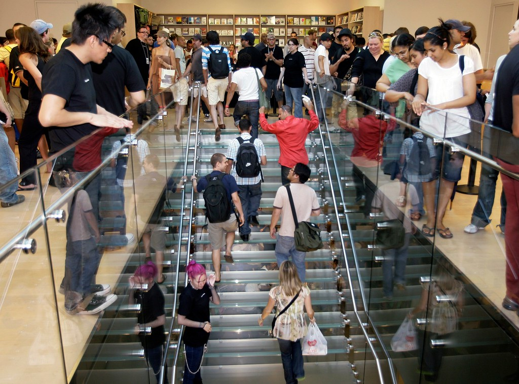 . Customers walk in to purchase the iPhone Friday, June 29, 2007 inside the Apple store at The Grove in Los Angeles. (AP Photo/Damian Dovarganes)
