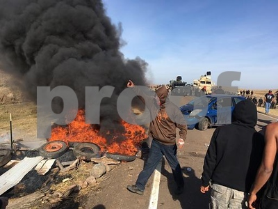 officers-evict-native-american-oil-pipeline-protesters-and-others-from-private-land