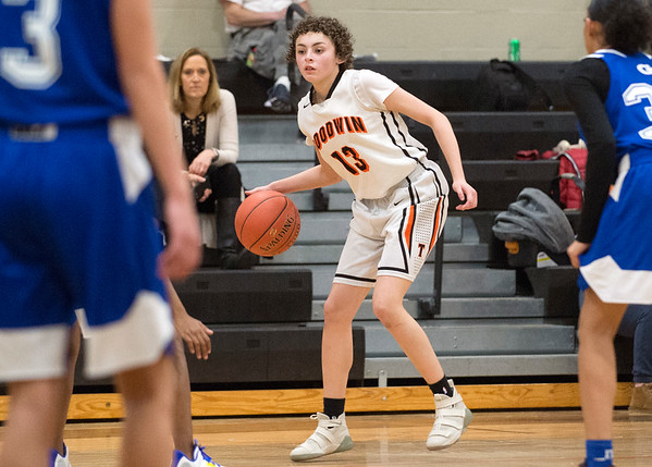01/31/20 Wesley Bunnell   StaffrrE.C. Goodwin girls basketball defeated Grasso Tech on Friday January 31, 2020 at home. Ericka Aponte (13) brings the ball downcourt looking for an open teammate.