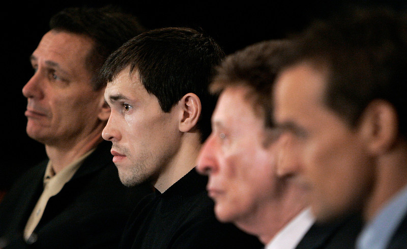 . Detroit Red Wings center Pavel Datsyuk of Russia, second from left, listens to a question during a news conference along with general manager Ken Holland, far left, team owner Mike Ilitch, third from left, and team vice president Steve Yzerman in Detroit, Friday, April 6, 2007. The Red Wings signed Datsyuk to a seven-year contract. (AP Photo/Paul Sancya)