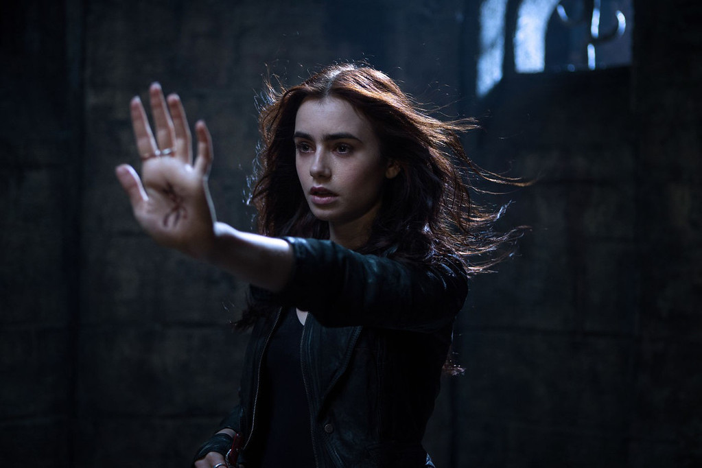 ". ""The Mortal Instruments: City of Bones,\"" out Aug. 21, stars Lily Collins who discovers she\'s a demon-fighting half-angel."
