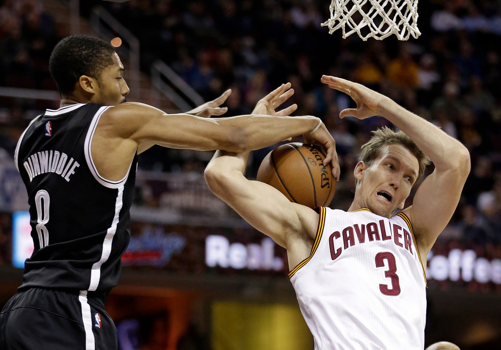 . Cleveland Cavaliers\' Mike Dunleavy (3) is stopped from driving to the basket by Brooklyn Nets\' Spencer Dinwiddie (8) in the second half of an NBA basketball game, Friday, Dec. 23, 2016, in Cleveland. (AP Photo/Tony Dejak)