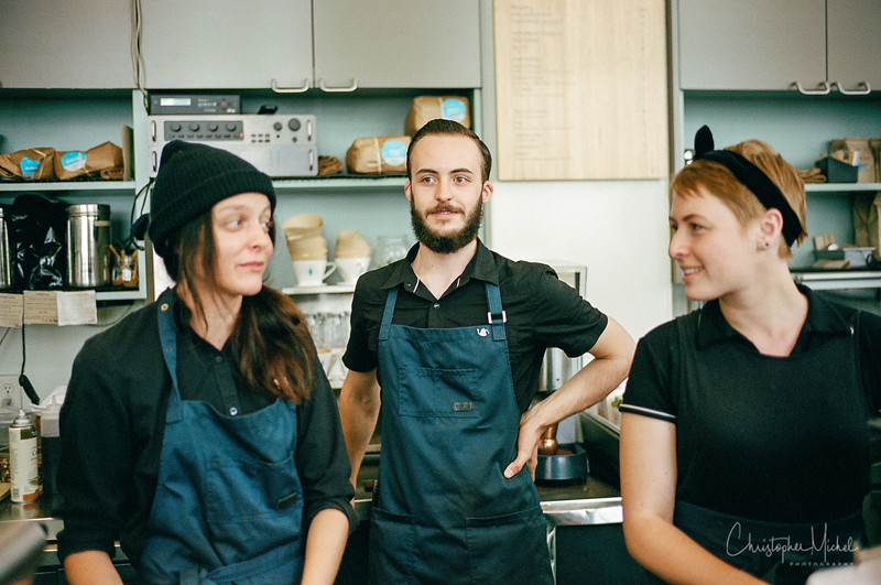 two girls and a guy blue bottle.jpg