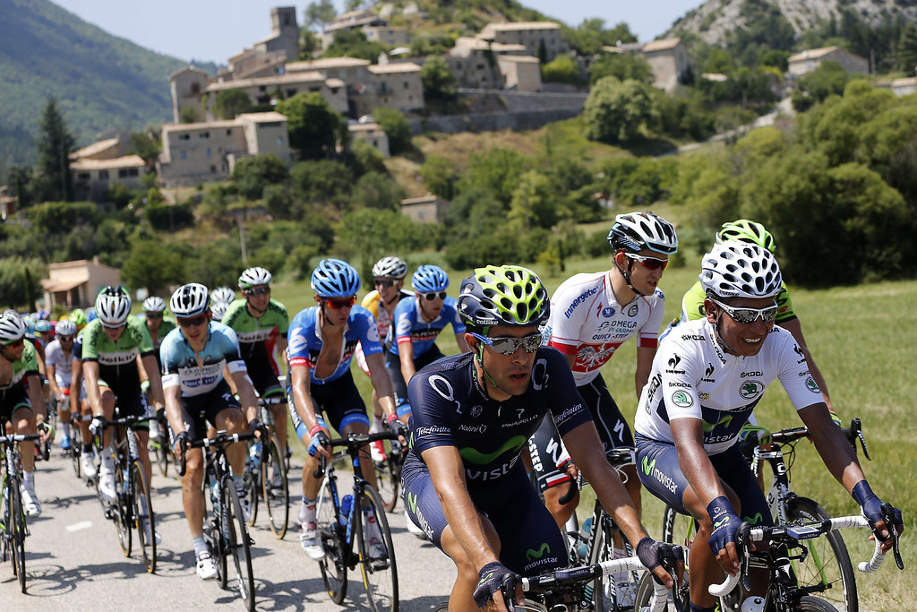 . Best young\'s white jersey Colombia\'s Nairo Quintana (L) rides in the pack during the 168 km sixteenth stage of the 100th edition of the Tour de France cycling race on July 16, 2013 between Vaison-la-Romaine and Gap, southeastern France.   JOEL SAGET/AFP/Getty Images