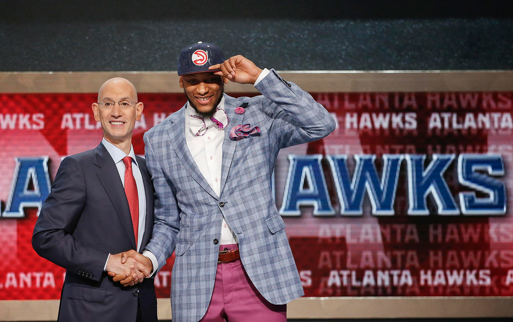 . Michigan State\'s Adreian Payne, right, poses for a photo with NBA commissioner Adam Silver after being selected as the 15th overall pick by the Atlanta Hawks during the 2014 NBA draft, Thursday, June 26, 2014, in New York. (AP Photo/Jason DeCrow)