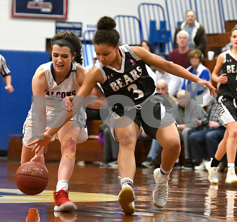 3/1/2018 Mike Orazzi | Staff St. Pauls Morgan Kolb (22) and Stonington's Aliza Bell (3) during the Class M Second Round of the CIAC 2018 State Girls Basketball Tournament in Bristol Thursday night.