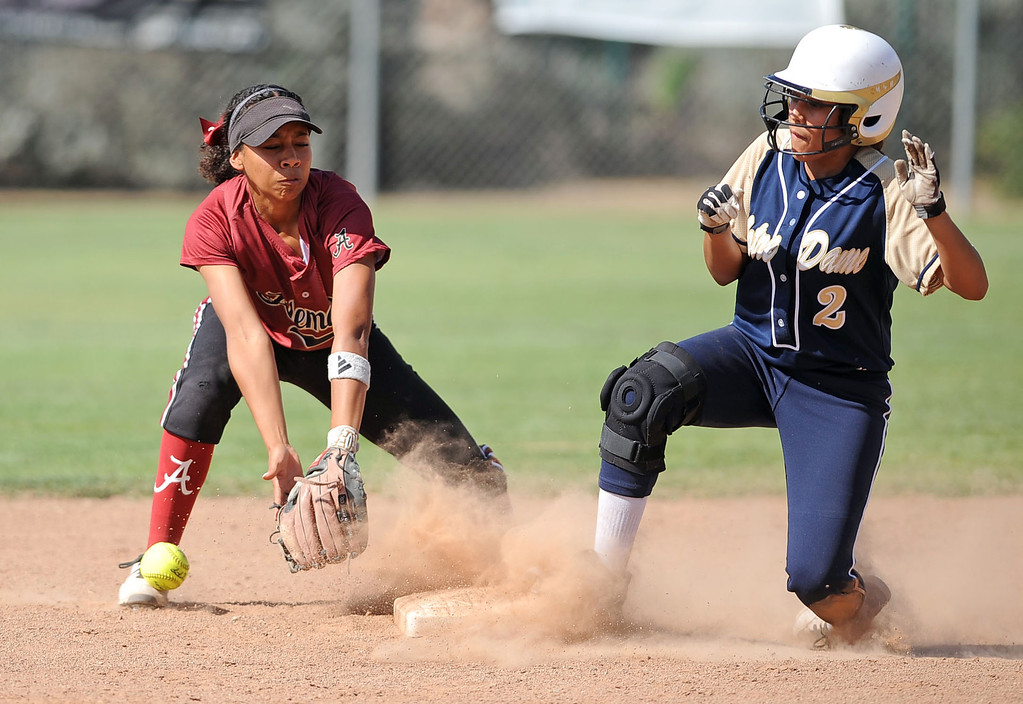 . Notre Dame\'s Bernadette Ochoa is safe at second as Madison Collins of Alemany tries to make a catch during their Mission League softball showdown in Encino, CA April 8, 2014.  Alemany won the game, 5-4.(Andy Holzman/Los Angeles Daily News)