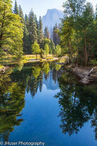 Vertical - Half Dome reflecting in water