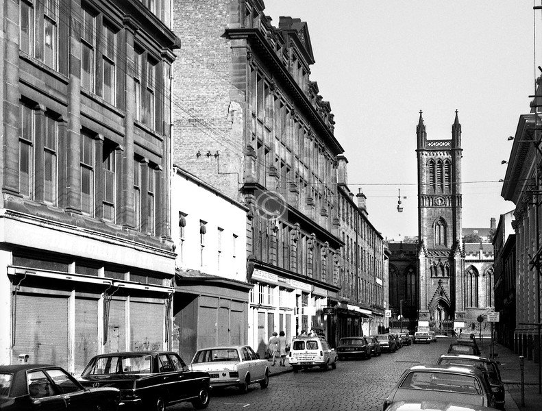 Candleriggs, west side.  The low block, which looks like a missing tooth, has been sympathetically raised to roughly the level of its neighbours.    September 1973