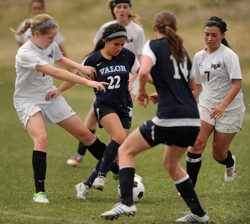 . PARKER, CO. - APRIL 2: Eagles midfielder amanda Lopez (22) dribbled through traffic in the first half. The Valor Christian High School girl\'s soccer team defeated Golden 4-1 Wednesday night, April 3, 2013.  Photo By Karl Gehring/The Denver Post)