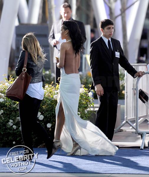 Rihanna Gives Fan A High-Five In Revealing Designed Dress