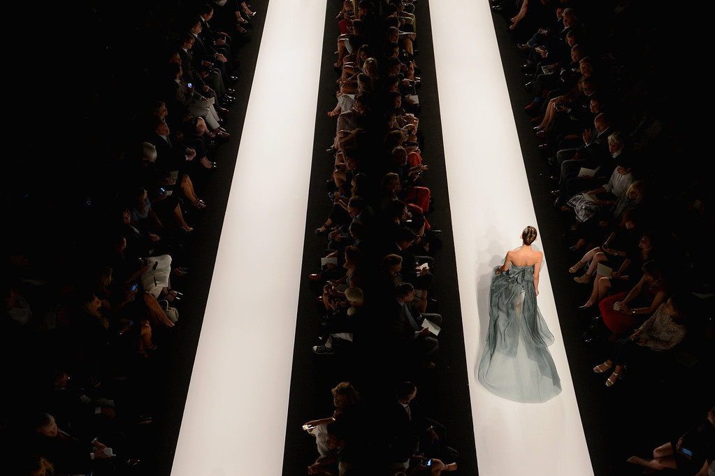 . A model walks the runway at the Carolina Herrera fashoin show during Mercedes-Benz Fashion Week Spring 2014 at Lincoln Center for the Performing Arts on September 9, 2013 in New York City.  (Photo by Karl Walter/Getty Images for Mercedes-Benz Fashion Week Spring 2014)