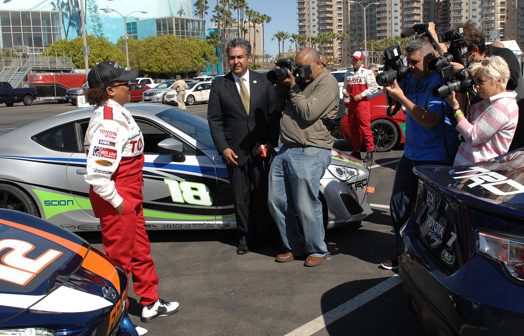 . 4/9/13 - Wanda Sykes poses for photographers during media day for the 39th Annual Toyota Grand Prix of Long Beach. The celebrity/pro races spent the day practicing on the track, joking with their racing partners and giving interviews. Photo by Brittany Murray / Staff Photographer