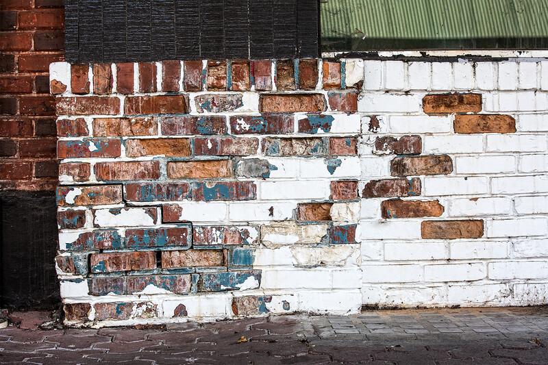 Bricks revealed through peeling paint. Seen in Skagit, Washing ton.