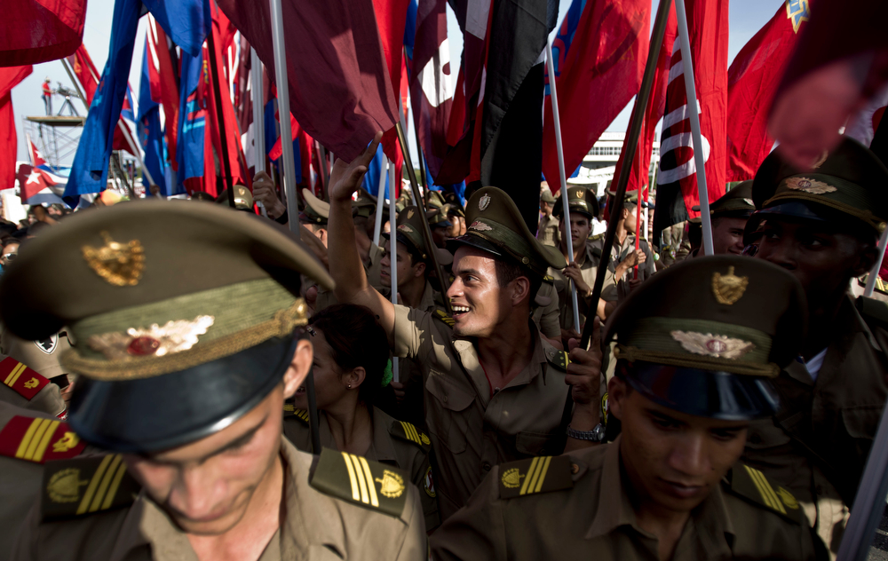 . Soldiers march carrying Cuban flags during the annual May Day parade in Havana, Cuba, Thursday, May 1, 2014. Cuba marks each May Day not with protests but with massive marches organized by workplaces, schools and government. (AP Photo/Franklin Reyes)