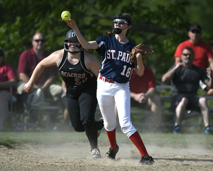 5/30/2018 Mike Orazzi | Staff St. Paul Catholic High School's Caleigh Mcdougall (18) and Somers' Kylie Thompson (23) during Wednesday's Class S Second Round Softball game in Bristol.