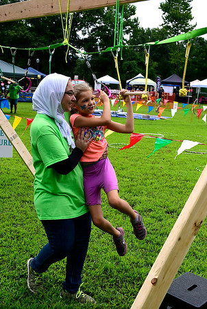 8/18/2018 Mike Orazzi | Staff Maha Kattaya helps Felicity Bayer in the ropes course during the Bristol West End Association's seventh annual summer festival at Rockwell Park Saturday.
