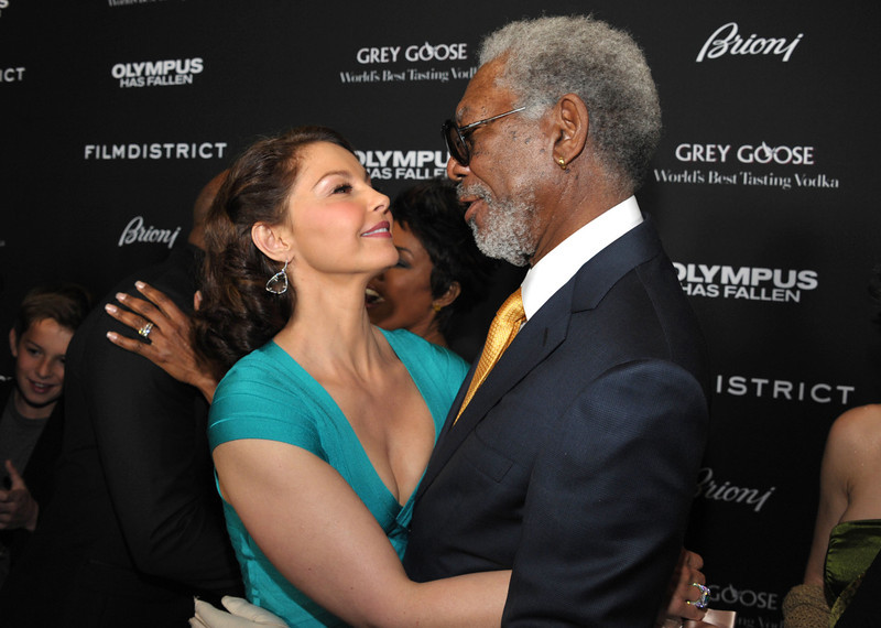 """. Ashley Judd, left, and Morgan Freeman arrive at the premiere of \""""Olympus Has Fallen\"""" at the ArcLight Theatre on Monday, March 18, 2013 in Los Angeles. (Photo by John Shearer/Invision/AP)"""