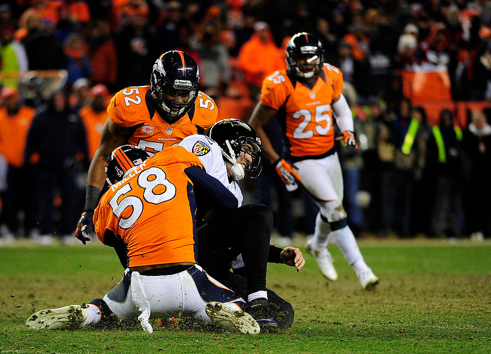 Description of . Denver Broncos outside linebacker Von Miller (58) tackled Baltimore Ravens quarterback Joe Flacco (5). The Denver Broncos vs Baltimore Ravens AFC Divisional playoff game at Sports Authority Field Saturday January 12, 2013. (Photo by AAron  Ontiveroz,/The Denver Post)