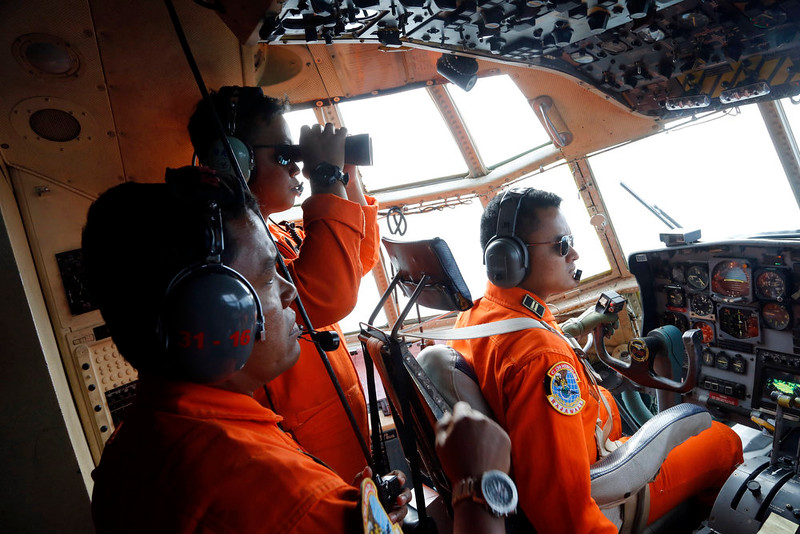 . Crew of Indonesian Air Force C-130 airplane of the 31st Air Squadron scan the horizon during a search operation for the missing AirAsia flight 8501 jetliner over the waters of Karimata Strait in Indonesia, Monday, Dec. 29, 2014. Search planes and ships from several countries on Monday were scouring Indonesian waters over which the AirAsia jet disappeared, more than a day into the region\'s latest aviation mystery. Flight 8501 vanished Sunday in airspace thick with storm clouds on its way from Surabaya, Indonesia, to Singapore. (AP Photo/Dita Alangkara)