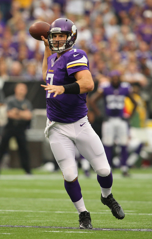 . Christian Ponder #7 of the Minnesota Vikings advances the ball against the Cleveland Browns on September 22, 2013 at Mall of America Field at the Hubert Humphrey Metrodome in Minneapolis, Minnesota. (Photo by Adam Bettcher/Getty Images)