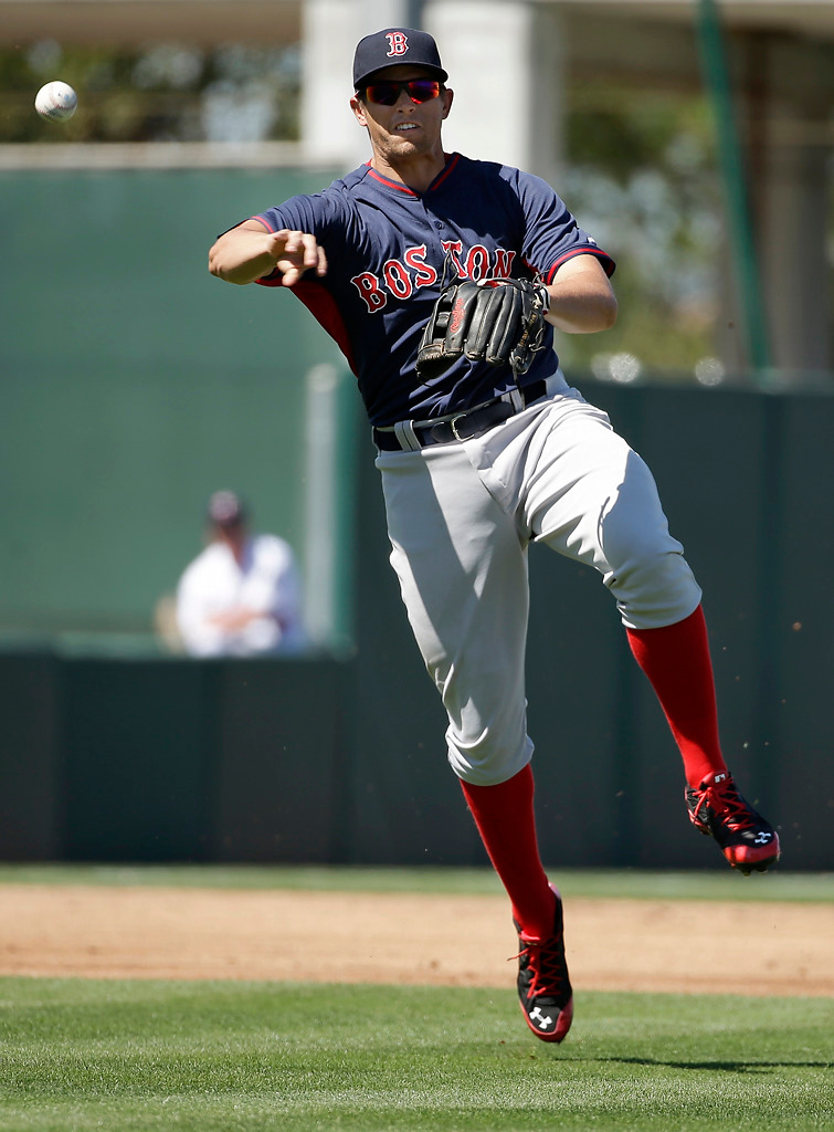 . Boston Red Sox third baseman Garin Cecchini, throws to first to retire Minnesota Twins\' Aaron Hicks in the first inning of an exhibition baseball game, Saturday, March 1, 2014, in Fort Myers, Fla. (AP Photo/Steven Senne)