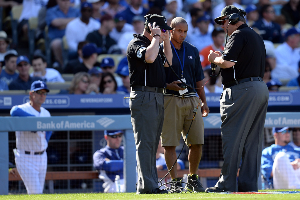 . Umpires wait for a ruling on a replay during the Dodgers  Giants game at Dodger Stadium Friday 4, 2014. The Giants beat the Dodgers 8-4.  (Photo by Hans Gutknecht/Los Angeles Daily News)