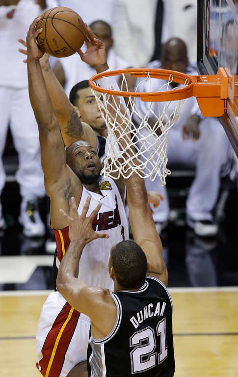 . The Miami Heat\'s Dwyane Wade (3) shoots over San Antonio Spurs\' Tim Duncan (21) during the second half in Game 7 of the NBA basketball championships, Thursday, June 20, 2013, in Miami. (AP Photo/Wilfredo Lee)