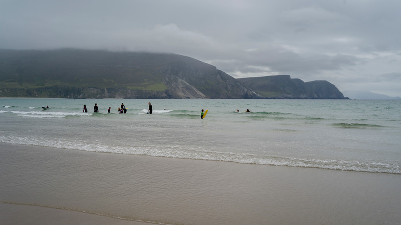Tourist enjoying on the beach, Keel Beach, Achill Island, County Mayo, Republic of Ireland
