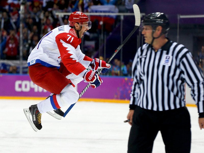 . Russia forward Ilya Kovalchuk reacts after scoring a goal against Finland during the first period of a men\'s quarterfinal ice hockey game at the 2014 Winter Olympics, Wednesday, Feb. 19, 2014, in Sochi, Russia. (AP Photo/Julio Cortez)