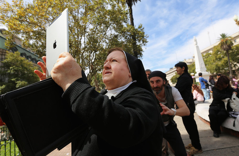 . A nun takes in activity with an iPad following Sunday Mass honoring Pope Francis outside the Metropolitan Cathedral on March 17, 2013 in Buenos Aires, Argentina. Francis was the archbishop of Buenos Aires and is the first Pope to hail from South America.  (Photo by Mario Tama/Getty Images)