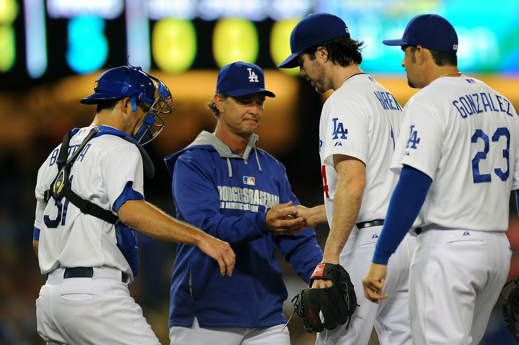 . Dodgers\' manager Don Mattingly comes to get pitcher Dan Haren after he gave up two runs in the fifth inning, Friday, July 11, 2014, at Dodger Stadium. (Photo by Michael Owen Baker/Los Angeles Daily News)