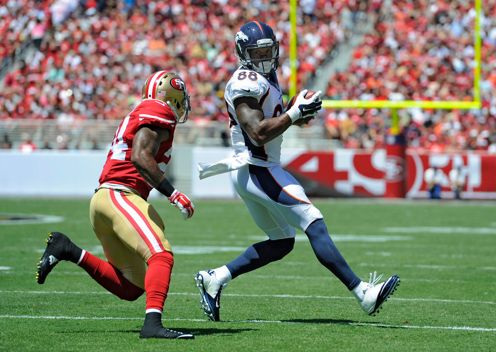 . Denver Broncos wide receiver Demaryius Thomas (88) puts a move on San Francisco 49ers strong safety Antoine Bethea (24) during the first quarter August 17, 2014 at Levi\'s Stadium. (Photo by John Leyba/The Denver Post)