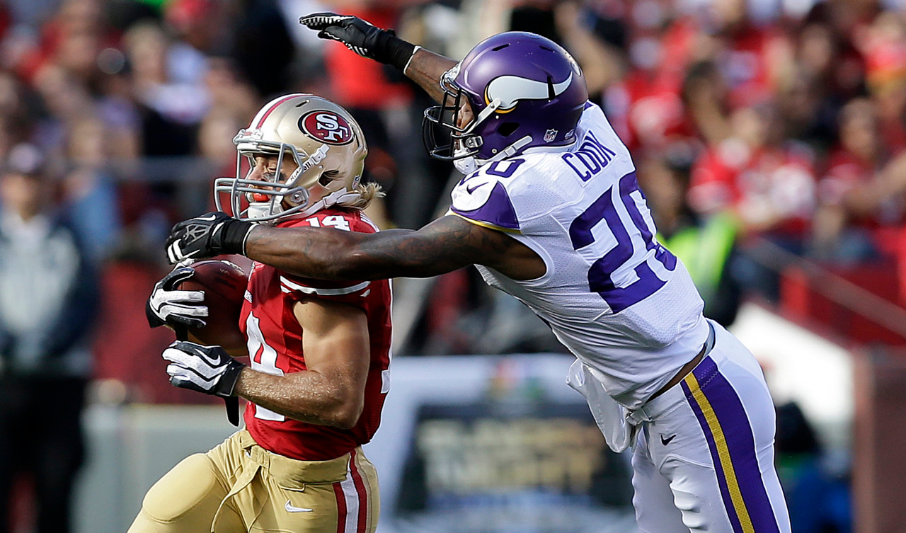 . 49ers wide receiver Chad Hall is tackled by Vikings defensive back Chris Cook  during the first quarter. (AP Photo/Marcio Jose Sanchez)