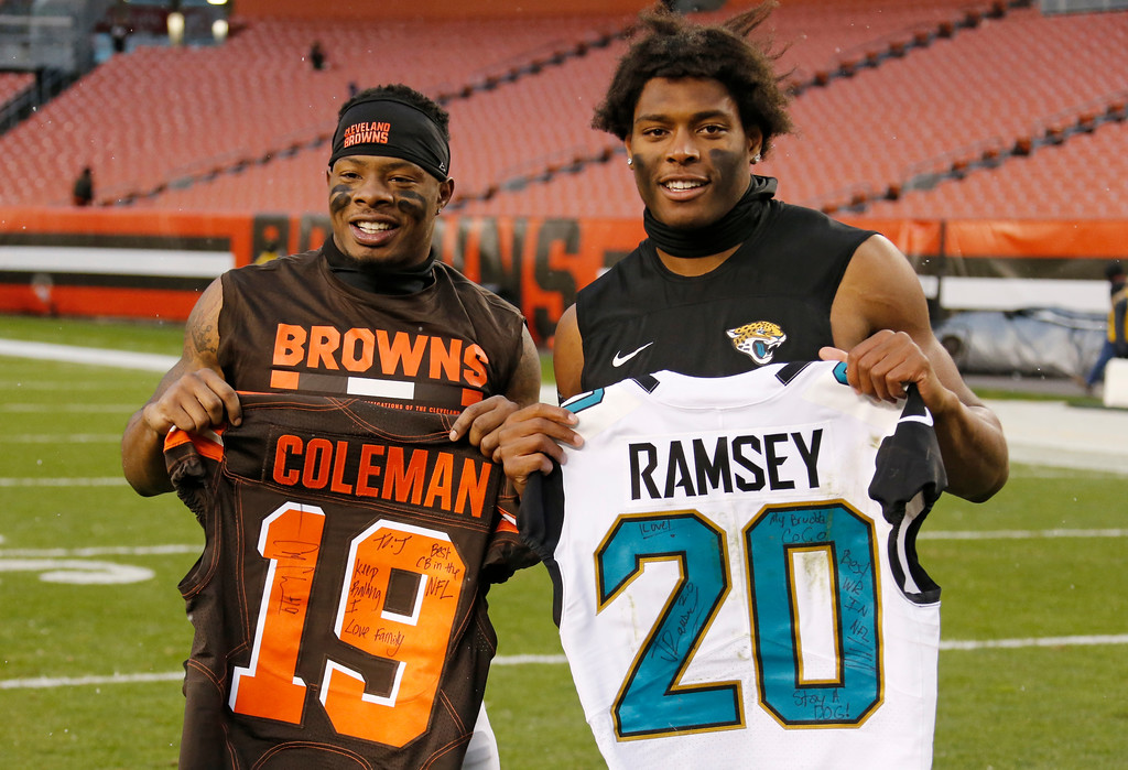 . Cleveland Browns wide receiver Corey Coleman, left, and Jacksonville Jaguars cornerback Jalen Ramsey hold up jersey\'s after an NFL football game, Sunday, Nov. 19, 2017, in Cleveland. (AP Photo/Ron Schwane)