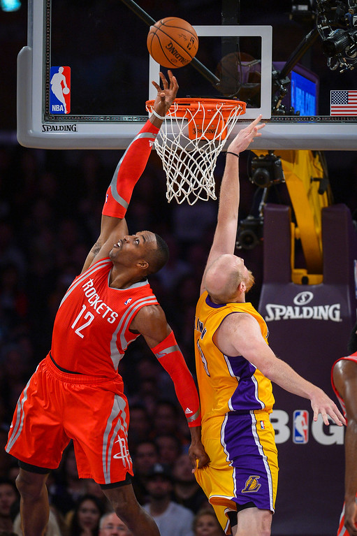 . Rockets� Dwight Howard gets the rebound away from Lakers� Chris Kaman during first half action at Staples Center Wednesday, February 19, 2014. ( Photo by David Crane/Los Angeles Daily News )