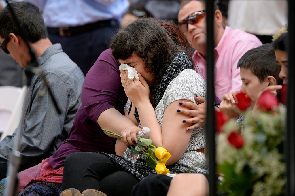 . Jennifer Nelson comforts her daughter Becca during a memorial service for her daughter Wiyanna Nelson and Wesley Quinlan at the National Center for Atmospheric Research in Boulder, CO September 21, 2013.  (Photo By Craig F. Walker / The Denver Post)