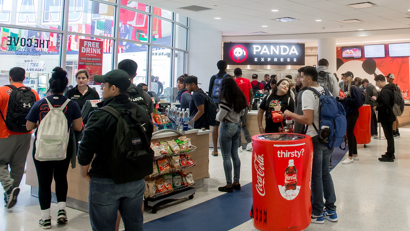 Student gather to buy lunch at The Cove food court in University Center.  The Cove bustles with hungry students during lunch.